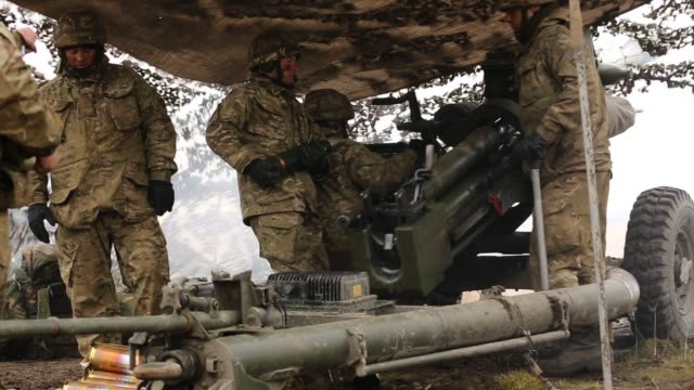 Royal Artillery gunners fire their 105mm light guns during a live firing exercise on February 20 2013 in Otterburn United Kingdom Artillery units...