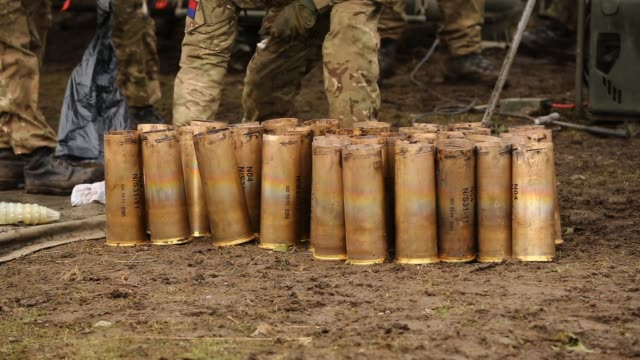 royal artillery gunners prepare to fire their 105mm light guns during a live firing exercise on february 20, 2013 in otterburn, united kingdom.... - infantry stock videos & royalty-free footage