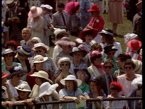 Royal Ascot ENGLAND Berks Ascot TGV Mass crowds walking in enclosure TMS Heads of crowd all wearing top hats and fashion hats MS Women at barrier TMS...