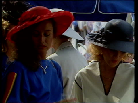 england berkshire ascot race course bv crowd of women cheering ms 2 young women posing and drinking ms another 2 sitting down ms more women in... - hüten stock-videos und b-roll-filmmaterial