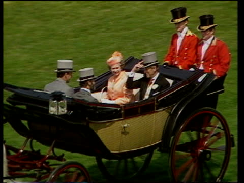 berkshire: ascot race course: ext royal procession along racecourse queen elizabeth ii and prince philip, duke of edinburgh along in open carriage... - elegance stock videos & royalty-free footage
