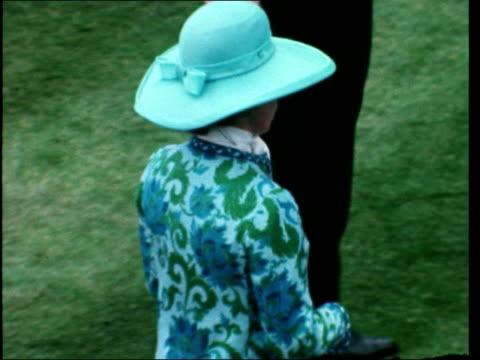 first day:; england: ascot race course: winner into enclosure - mercer dismounts: bv princess anne l-r : mercer l-r through crowd: joe mercer: sof:... - ロイヤルアスコット点の映像素材/bロール