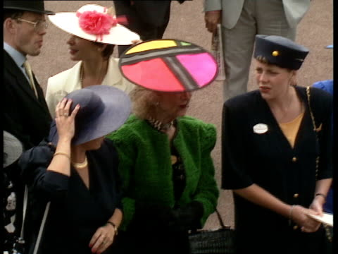 ladies day 10 woman in creamcoloured suit and hat resembling bouquet of roses woman wearing circular hat in fluorescent colours gv crowd tv cameraman... - princess michael of kent stock videos and b-roll footage