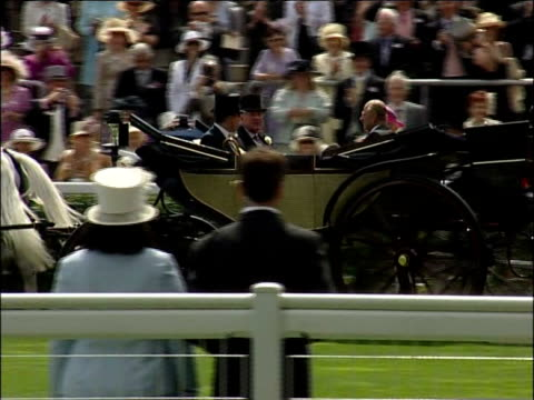 Royal Ascot Royal procession along at racecourse including Queen in carriage Queen getting out of carriage Woman along Group of people