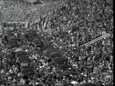 second day england berkshire ascot racecourse gvs crowds with umbrellas gvs carriage procession along with queen elizabeth ii and prince philip duke... - floral pattern stock videos & royalty-free footage
