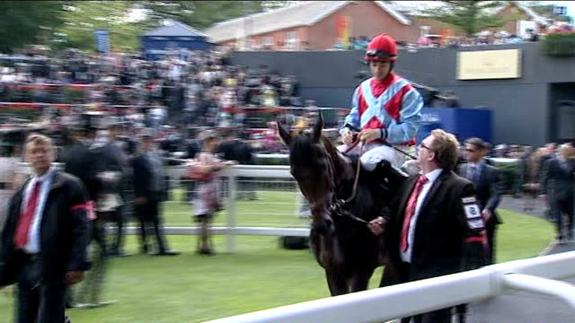 Royal Ascot Spectators in stand Racegoers in top hats and fancy hats Johnny Murtagh on horse in winner's enclosure Bookmakers offering odds to crowd...