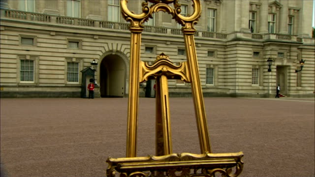 royal baby announcement displayed at buckingham palace england london buckingham palace ext general views of easel / car along then stops / man hands... - easel stock videos and b-roll footage