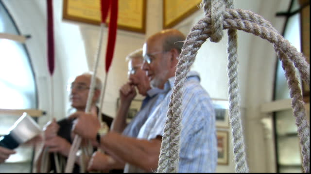 bell ringing at westminster abbey england london westminster abbey int certificates on wall of bell tower/ ropes being lowered down and untied / bell... - untied stock videos and b-roll footage