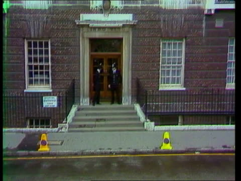 england london paddington st mary's hospital ext sign lindo wing pull back ms nurses wait pan flowers into hospital ms crowd ms ditto behind barrier... - zoom out stock videos & royalty-free footage