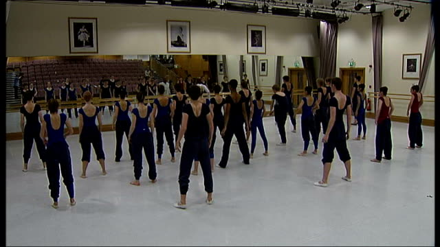 royal ballet school teaches commercial dance to pop music soundtrack royal ballet school good shots various of ballet students doing warmup exercises... - soundtrack stock videos & royalty-free footage