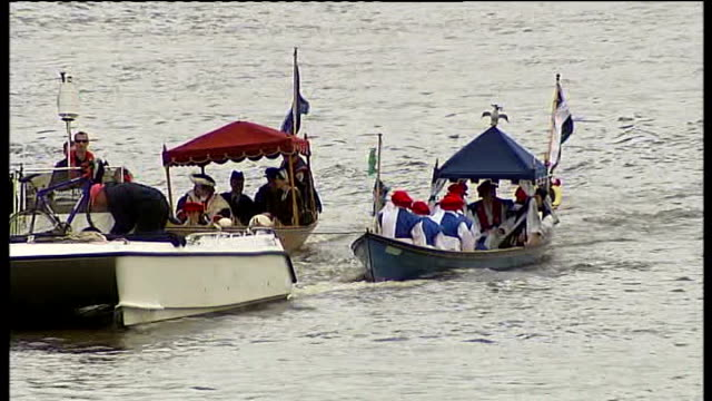 Royal barge rowed along Thames Reporter to camera Henry the Eighth flotilla along Thames henry waving from royal barge Hampton Court Crowds and...