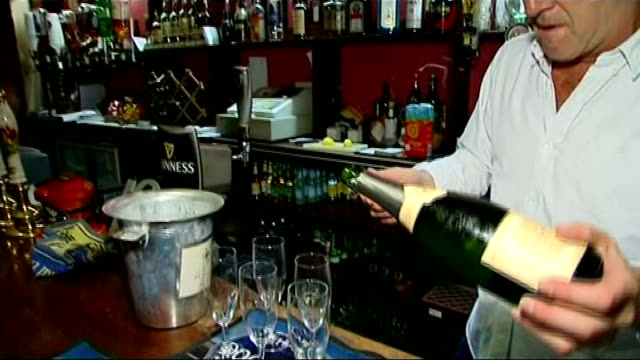 Baby boy born to the Duke and Duchess of Cambridge ITV News Special PAB 09251030 Berkshire Bucklebury Old Boot Inn INT Landlord John Haley pouring...