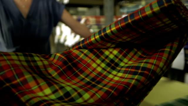 economic impact location unknown int interior of scottish tartan mill close shot weaving equipment reporter looking at tartan scarf close shots... - tartan stock videos & royalty-free footage