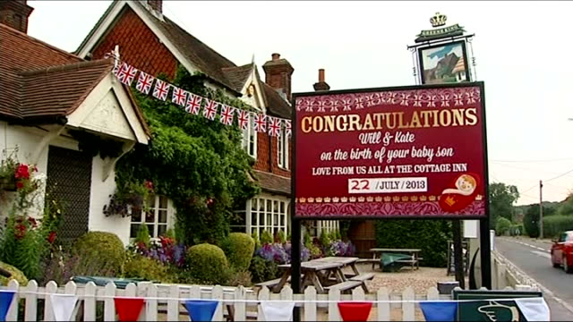 Reaction in UK and around the world ENGLAND Berkshire Bucklebury EXT Exterior of 'The Cottage Inn' pub Sign outside pub reading 'Congratulations Will...