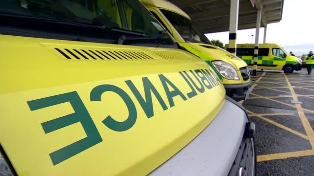 Royal Blackburn Hospital general views ENGLAND Lancashire Blackburn EXT Ambulances outside hospital Anonymous shots people in waiting room / TRACKING...
