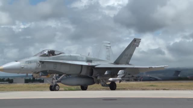 royal canadian air force cf18 hornet aircraft are loaded with aim7 sparrow missiles at joint base pearl harborhickam honolulu hawaii usa to conduct a... - afterburner stock videos and b-roll footage