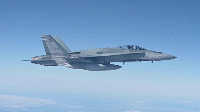 royal canadian air force cf-18 hornet's conduct aerial refueling with royal canadian air force cc-150t polaris tanker during a general flight to... - air to air shot stock videos & royalty-free footage