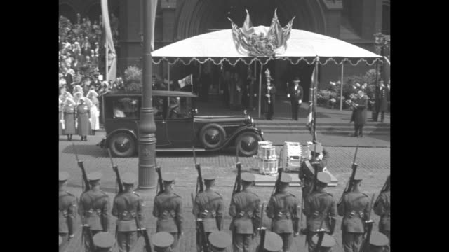 ms royal car drives between rows of soldiers standing at attention large platform with crowd on it and a group of nurses standing in street as people... - battalion stock videos and b-roll footage