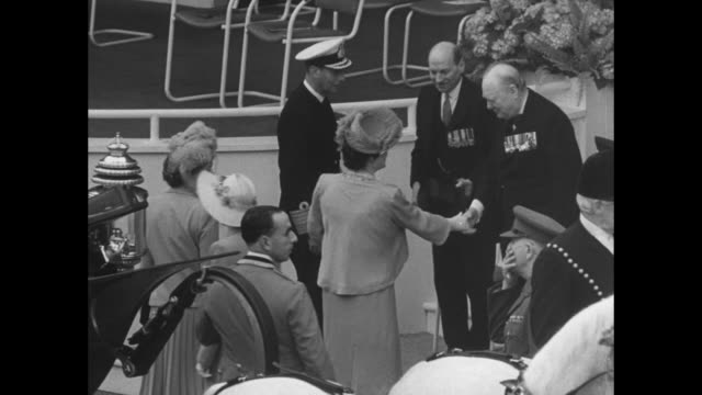 royal carriage approaches in procession on london street during day of victory parade celebrating allied world war ii victory / cu king george vi... - winston churchill prime minister stock videos and b-roll footage