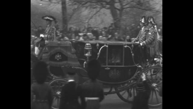 royal carriage bearing princess marina of greece and denmark leaves buckingham palace with captain's escort she waves from inside carriage her father... - カンタベリー大主教点の映像素材/bロール