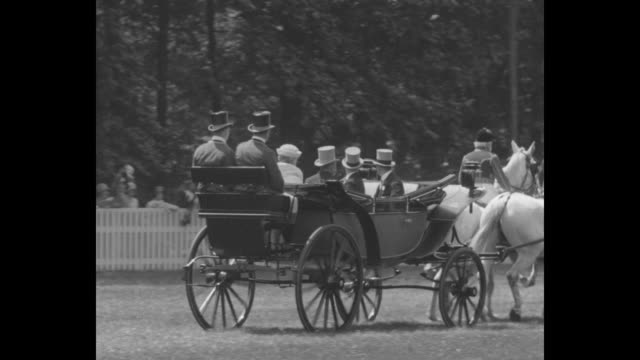 royal coach bearing george v and queen mary passes as the couple arrives for race at ascot; prince henry, duke of gloucester, and edward, prince of... - railings stock videos & royalty-free footage