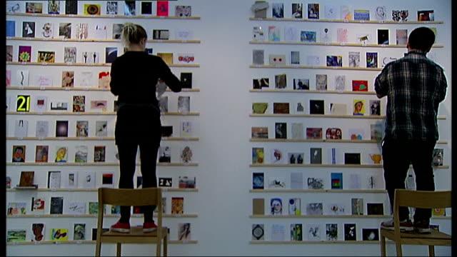 royal college of art secret postcard sale england london battersea royal college of arts int 'rca secret' sign pan staff with secret postcard sale... - postcard stock videos and b-roll footage