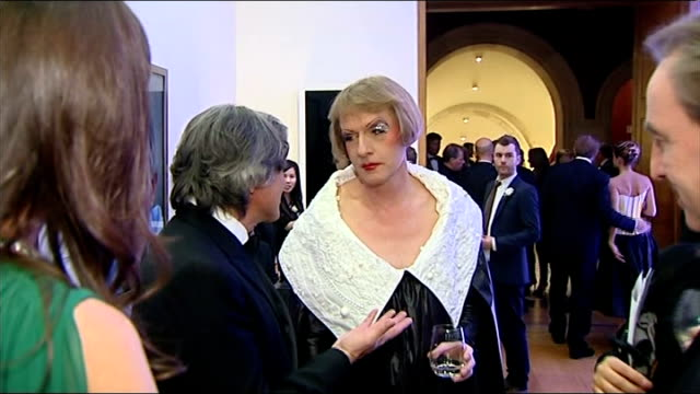 royal college of art secret postcard sale lib / london national portrait gallery grayson perry talking to someone in gallery - postcard stock videos and b-roll footage