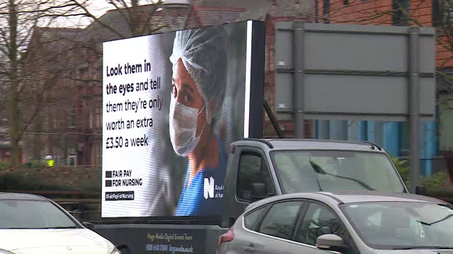 royal college of nursing sign parked outside salford hospital, protesting against the proposed one per cent pay rise for nhs staff - symbol stock videos & royalty-free footage