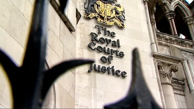 ext crest of the royal courts of justice close up railings reporter to camera - news of the world stock videos & royalty-free footage