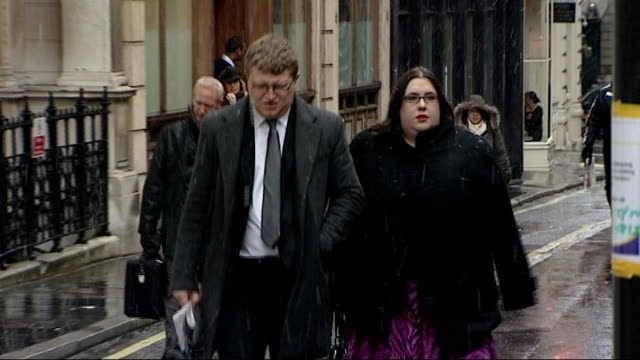 paul mitchell along towards inquest with unidentified woman - paul mitchell stock videos and b-roll footage