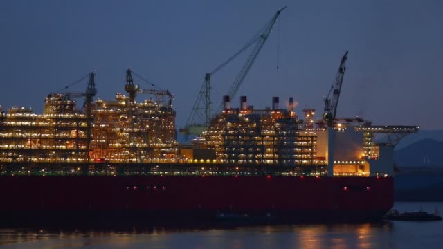 Royal Dutch Shell Plc's Prelude floating liquefied natural gas facility is illuminated at dusk at the Samsung Heavy Industries Co shipyard in Geoje...