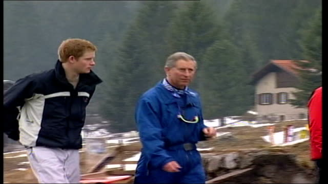 royal editor of 'news of the world' faces jail over phone-tap case; lib switzerland: klosters: snow on ground prince charles, prince of wales towards... - news of the world stock-videos und b-roll-filmmaterial