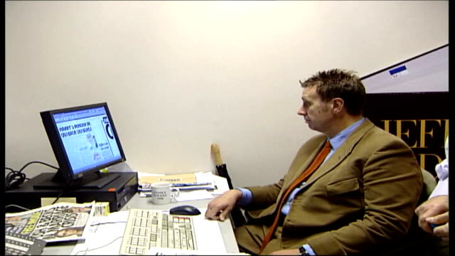 royal editor of 'news of the world' faces jail over phonetap case tx goodman sitting looking at computer screen in office dissolve to - news of the world stock videos & royalty-free footage