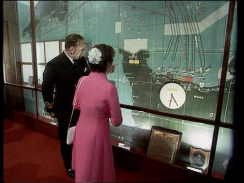 Royal Family attend celebrations Southwick House MS SIDE Princess Margaret in map room as guided by naval officer PAN MS Group of Veteran WRENS...