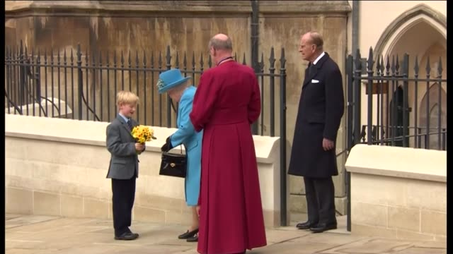 royal family attend easter church service in windsor small boy waiting with flowers / queen and duke of edinburgh from church and queen presented... - st. george's chapel stock videos and b-roll footage
