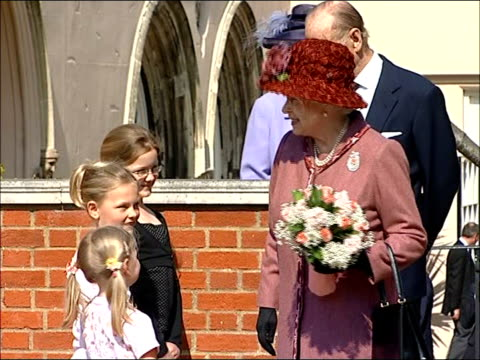 royal family attending easter sunday church service at windsor queen leaving service and being given flowers by children / queen and prince philip... - religious service stock videos & royalty-free footage