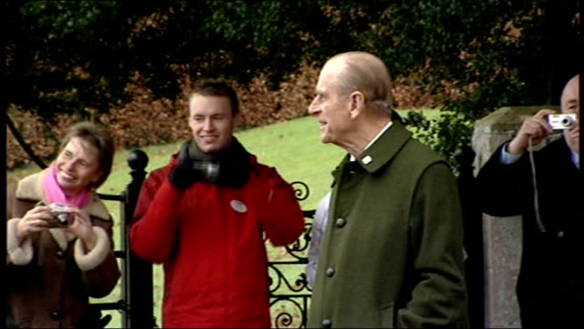 Royal family depart church on Christmas Day Prince Philip chatting members of public Prince William standing outside church with Peter Phillips Zara...