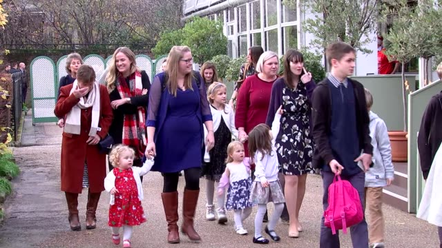 royal family hosts christmas party at kensington palace; england: london: kensington palace: ext various of military families arriving to attend... - fake snow stock videos & royalty-free footage
