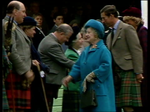 royal family visit highland games itn braemar queen shaking host as prince philip rl out of car cms prince charles princess diana wearing maroon... - highland games stock videos & royalty-free footage