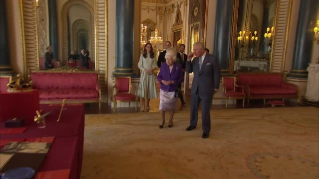 royal family walk through reception room at buckingham palace at event to mark the 50th anniversary of the investiture of prince charles - raw footage stock videos & royalty-free footage