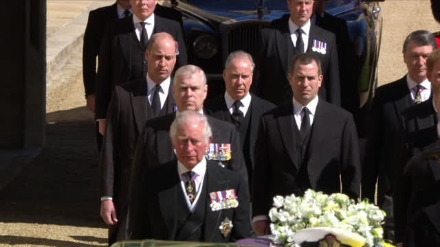 royal family walking behind the land rover hearse in the funeral cortege for prince philip, duke of edinburgh, in the grounds of windsor castle - mourning stock videos & royalty-free footage