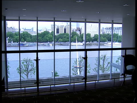 royal festival hall after refurbishment woman up stairs / stairs / new carpeting / stairs / tables and chairs on gallery / view of the london eye and... - royal festival hall stock videos & royalty-free footage