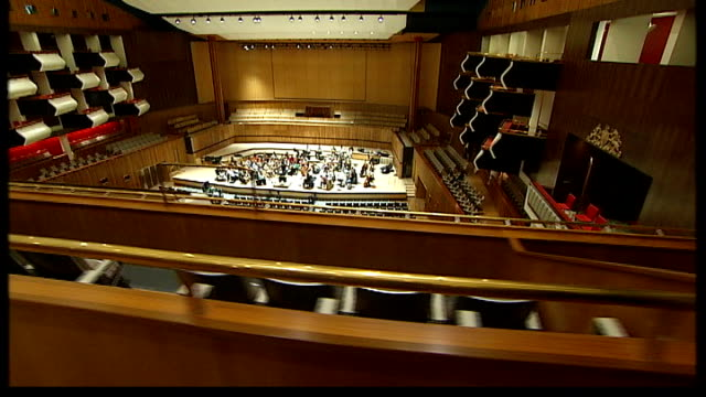 royal festival hall refurbished tracking shot through auditorium as orchestra rehearses sot - royal festival hall stock videos & royalty-free footage
