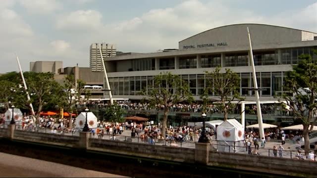 royal festival hall reopens; england: london: south bank: royal festival hall: ext crowds watching free events on riverside walkway dancers... - ロイヤルフェスティバルホール点の映像素材/bロール