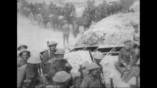 royal fusiliers from leicester and northumberland march towards the trenches during the battle of arras - erster weltkrieg stock-videos und b-roll-filmmaterial