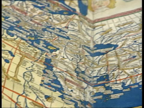 stockvideo's en b-roll-footage met journalists round table of documents cms white glove pulled on ms official showing 15th century map of the world tolemy's cosmographia cms detail of... - tenzing norgay