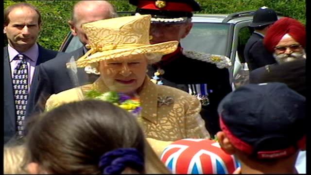 queen and prince philip visit gunnersbury park museum; england: london: gunnersbury park museum: ext car car carrying queen and prince philip, the... - duke of edinburgh stock videos & royalty-free footage