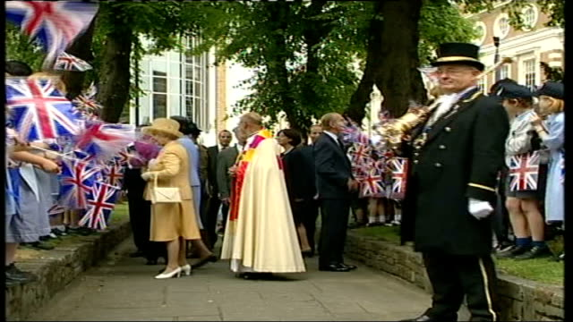 vídeos de stock e filmes b-roll de queen elizabeth and prince philip visit kingstonuponthames england kingstonuponthames all saints parish church ext line up of clergy and local... - clero