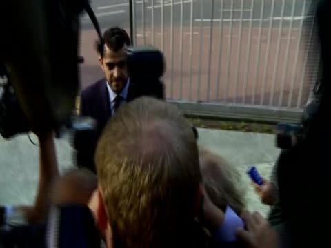 royal lawyer aurelien hamelle is surrounded by journalists as he walks up the steps to the tribunal of nanterre following the publication of kate... - publication stock videos & royalty-free footage