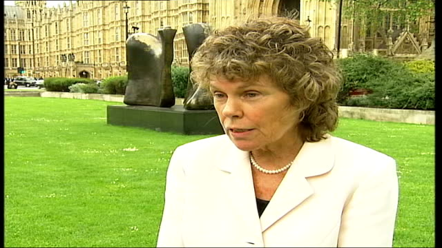 Bosses apologise for service ITN ENGLAND London EXT CMS postman's delivery bag as he walks along TRACK Kate Hoey MP interview SOT They were very keen...